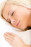 Close up of sleepy woman in bed stock image