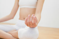 Close up of slender woman meditating sitting in lotus position Royalty Free Stock Photos