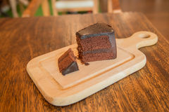 Close up Slice of chocolate cake on wood table. Slice of chocolate cake on wood table Royalty Free Stock Photos