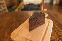 Close up Slice of chocolate cake on wood table. Slice of chocolate cake on wood table Stock Photography