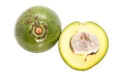 Closeup Slice of green thai avocado on white background. Close up Slice of green thai avocado on white background stock photos