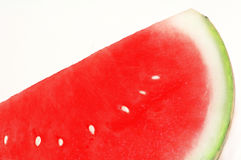 Close-up of a slice of a red watermelon. On white isolated background Stock Image