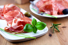 Close up of sliced coppa with herbs Royalty Free Stock Photos