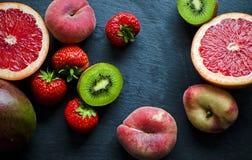 Fresh Fruit on a Slate. Close up of sliced fresh fruit on a slate royalty free stock image