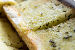 Close up sliced homemeade garlic bread  with nobody. Selective focus Royalty Free Stock Photo