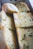 Close up sliced homemeade garlic bread  with nobody. Selective focus Royalty Free Stock Photos