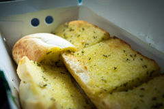 Close up sliced homemeade garlic bread  with nobody. Selective focus Royalty Free Stock Image