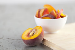 Close-Up of Sliced Peach on Rustic Table Royalty Free Stock Image