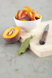Close-Up of Sliced Peach on Rustic Table Stock Photo