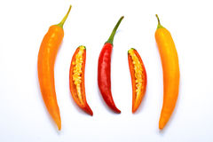 Close up sliced red and orange chilli pepper white isolated Stock Photos