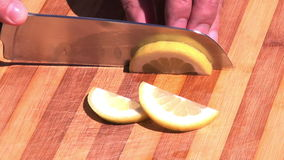 Close up on slicing a lemon Royalty Free Stock Photography