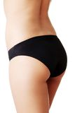 Close up on slim woman buttocks in underwear royalty free stock images