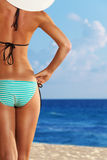Close-up of slim woman on the sea beach Stock Photos