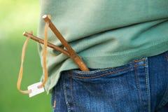 Close Up Of Slingshot In Boy's Trouser Pocket Stock Images