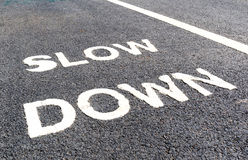 Close up slow down marking on street, for warning the drivers to Royalty Free Stock Photos