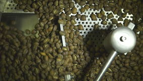 Close up slow motion shot of coffee production indrustry, drying raw coffe beans in a machine stock footage