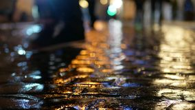 Asphalt rain people evening stock footage