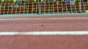 Close up slow motion video footage feet of a runner in sneakers stock video