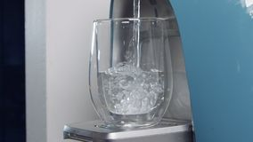 Slow motion of a water cup filling in a water filtering machine stock video footage