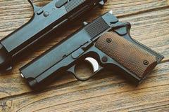 Close-up of small black gun compact handgun Royalty Free Stock Photo