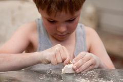 Close up of Small boy and art project Stock Photo