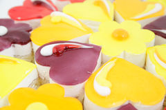 Close up of small cakes with different stuffing. Small cakes with different stuffing Stock Image