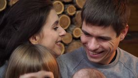 Close-up of small children and parents kissing stock video