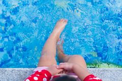 Close up small leg kid wet water. royalty free stock photo