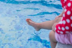 Close up small leg kid wet water. stock photography