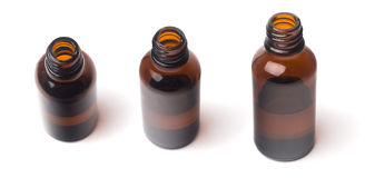 Close up of a small medical brown glass bottle  on white different views Stock Photos