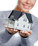 Close up of model house in female hands Royalty Free Stock Photos