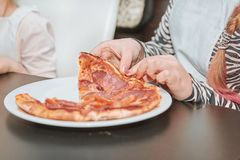 Close up. small participants of the master class eat pizza. Cooking pizza together stock photos
