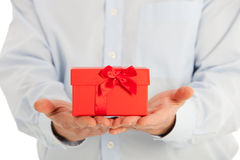 Close up Small Red Gift Box on Top of the Hands Stock Photo