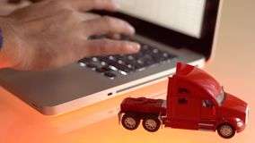 Close-up of a small red toy truck on laptop keypad.  stock video