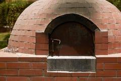 Close Up of Small Rural  DIY Brick Smokehouse Ready for BBQ Stock Photo