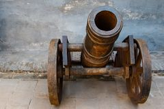 Rusting cannon on metal cart. Close up of a small rusting cannon mounted on a rusting cart Royalty Free Stock Images