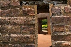 Close up of small window on brick wall. Close up of small window on the weathered brick wall Stock Photos
