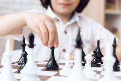 Close up. Smart boy move by bishop. Game of chess. royalty free stock photos
