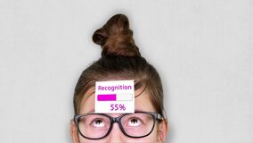 Close-up, a smart teenager face, a child in glasses, with a sticker on his forehead. an animation of Recognition process