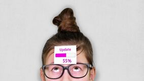 Close-up, a smart teenager face, a child in glasses, with a sticker on his forehead. an animation of Update process