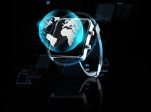 Close up of smart watch with earth globe Stock Image