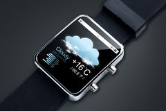 Close up of smart watch with weather forecast app. Modern technology, objectm, weather and media concept - close up of black smart watch with forecast app and Stock Image