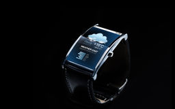 Close up of smart watch with weather forecast. Modern technology, weather cast, object and media concept - close up of black smart watch with meteo forecast on Stock Photos