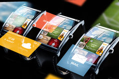 Close up of smart watches with news application Royalty Free Stock Photo