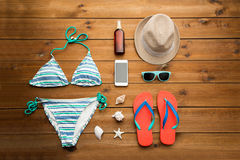 Close up of smartphone and beach stuff Royalty Free Stock Image