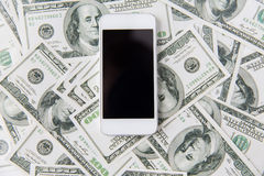 Close up of smartphone and dollar money. Business, finance, technology and e-commerce concept - close up of smartphone with black blank screen and dollar money Stock Photography