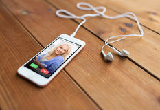 Close up of smartphone and earphones on wood Stock Images