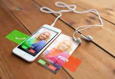 Close up of smartphone and earphones on wood Royalty Free Stock Photo