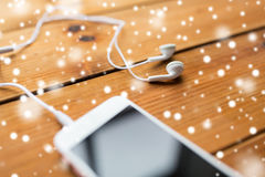Close up of smartphone and earphones on wood Stock Image