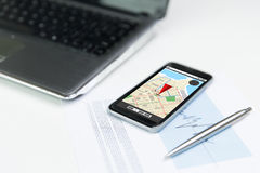 Close up of smartphone with gps navigator map. Business, technology, navigation and location concept - close up of smartphone with gps navigator map on screen Stock Photo